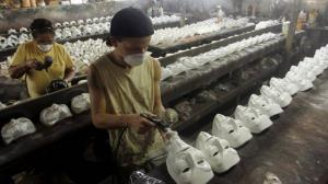 guy fawkes masks in sweatshop
