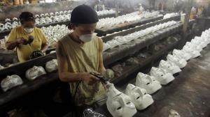 guy fawkes masks in sweatshop